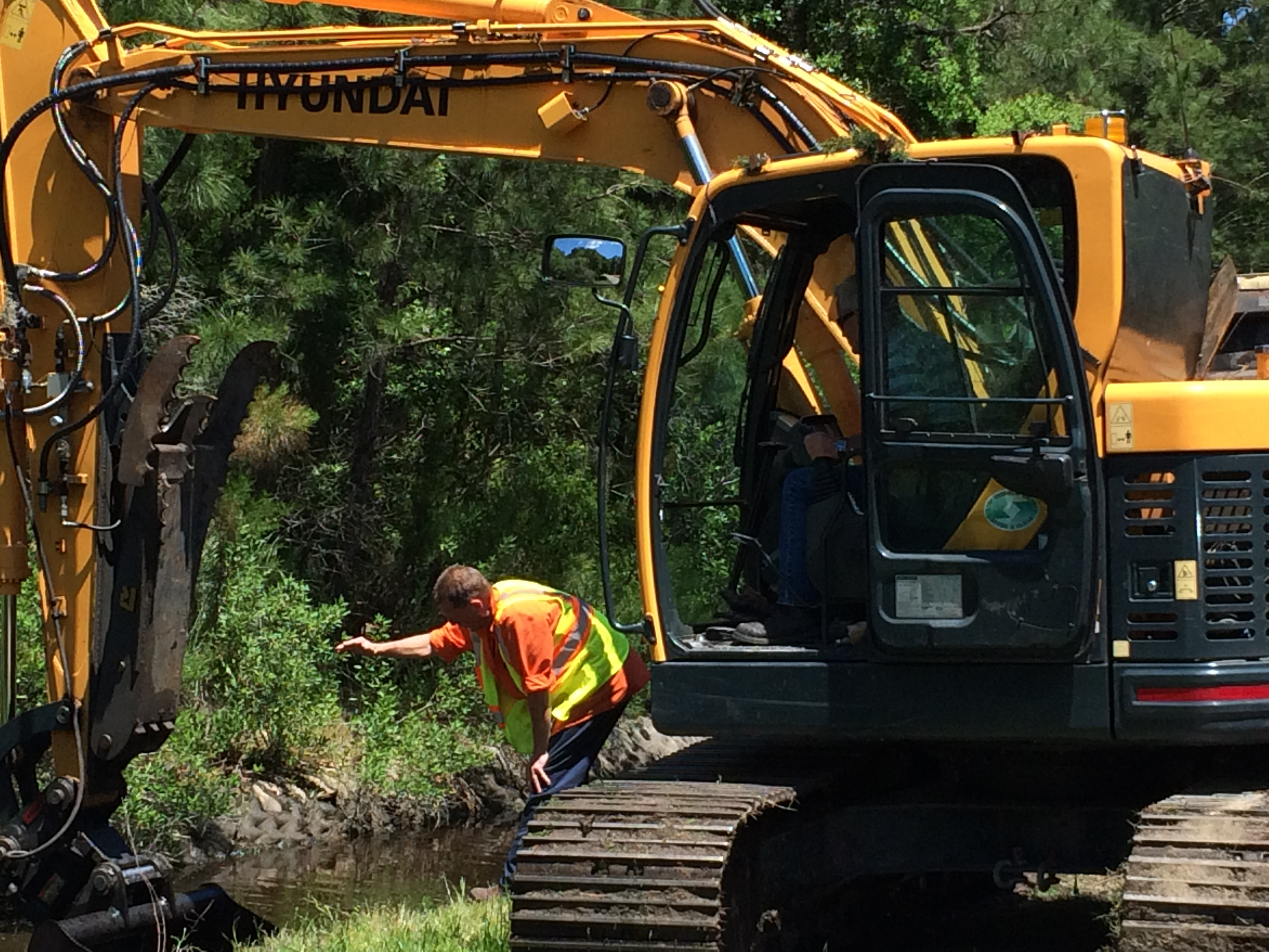 The City crew is use heavy equipment to prevent flooding by ensuring ditches are clear to convey the storm water.